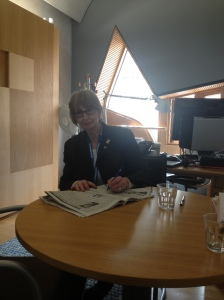 "Jean signing the ""Drop the Debt"" petition in Parliament."
