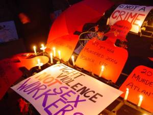 """Candles and messages commemorating dead sex workers: """"Annette Nicholls, 29 years old, Murdered 2006, Ipswich, UK,"""" """"Fight violence, not sex workers."""""""