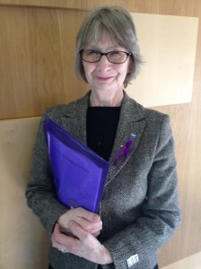 Jean wearing her purple ribbon (and sporting a purple folder!) for Purple Day.