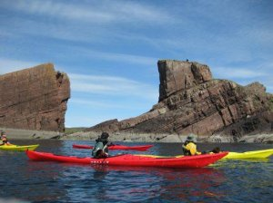 Kayaking round Achiltibuie. Photo: North West Highlands Geopark